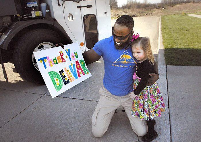 little girl meets garbage man