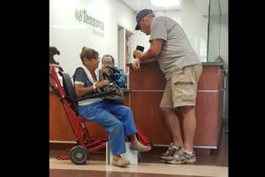veteran helps old woman