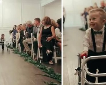 down syndrome baby walks wedding aisle