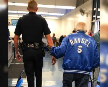 police officer helps elderly