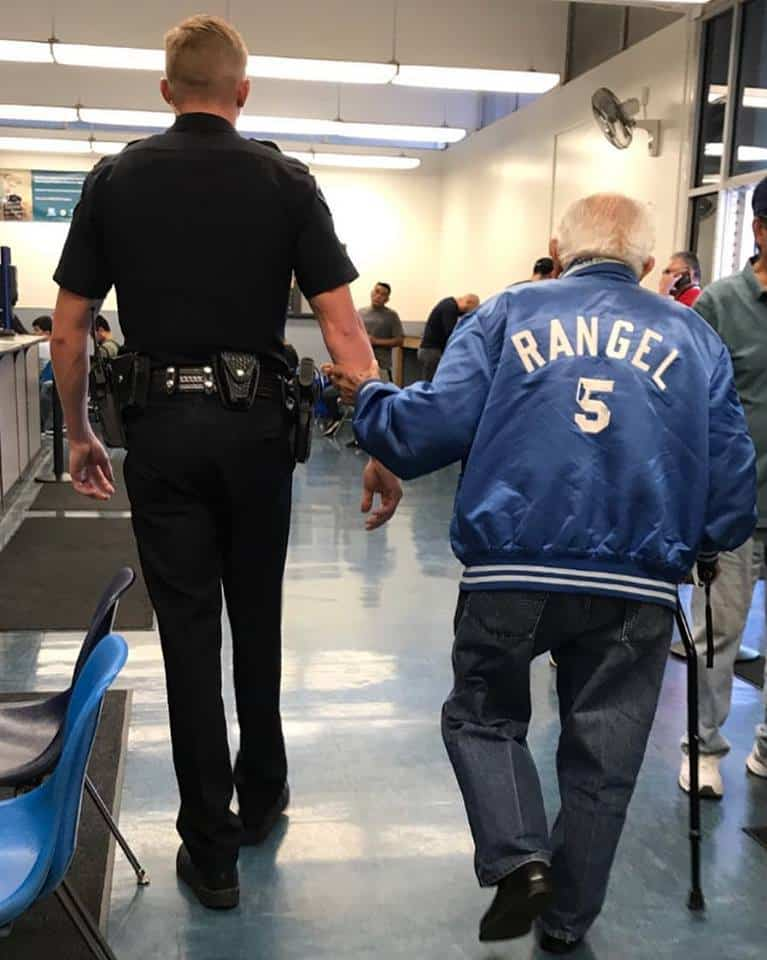 police officer helps elderly