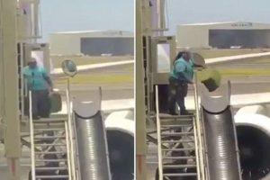 baggage handler throwing suitcases video