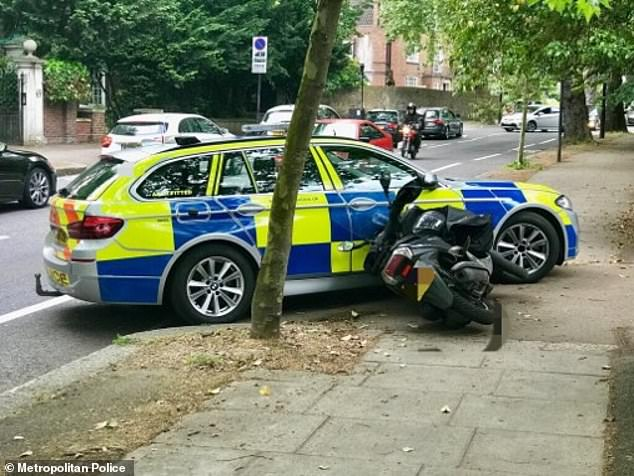 police knocking moped muggers